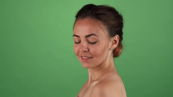 Young beautiful woman posing elegantly on chromakey