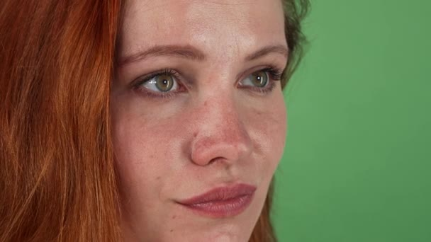 Young beautiful ginger haired woman looking to the camera