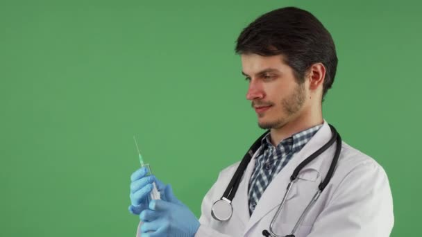 Handsome male doctor preparing syringe with vaccine