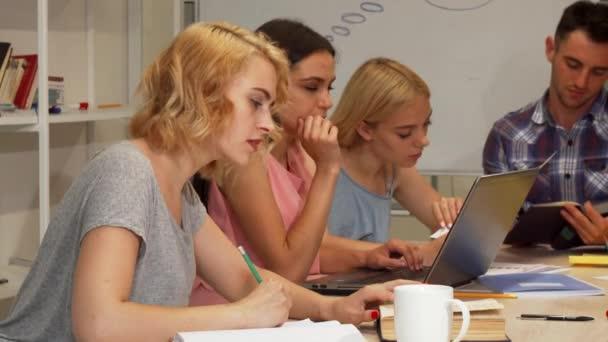 Group of students studying at university auditorium