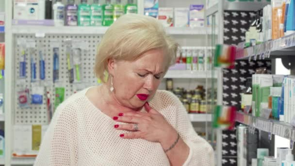 Elderly woman feeling sick, looking for medicine at local pharmacy