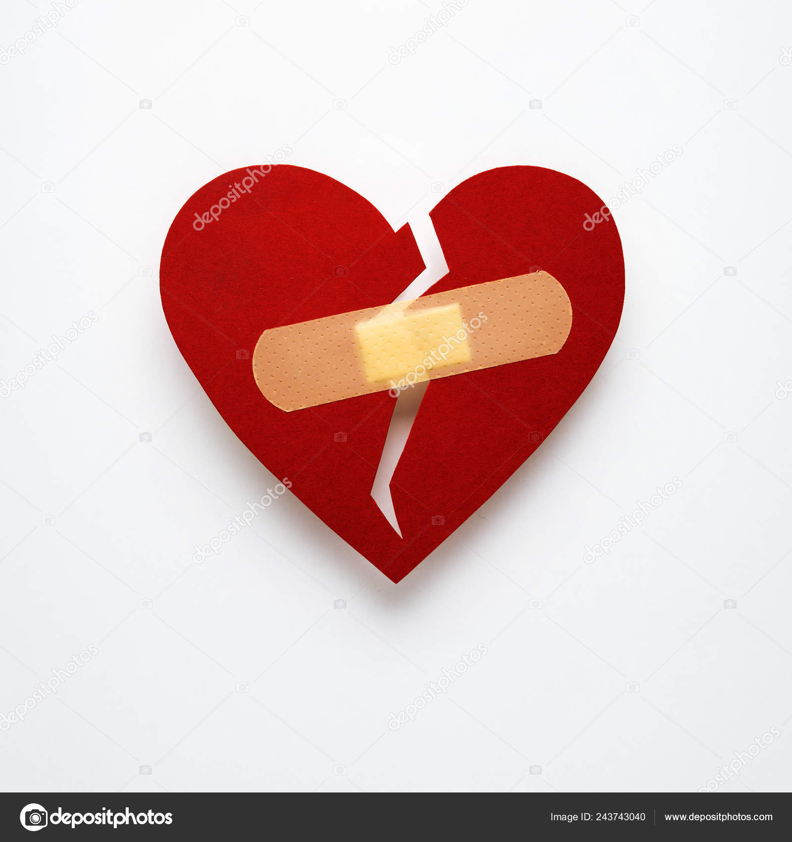 Pictures: broken heart with plaster image | Creative Concept
