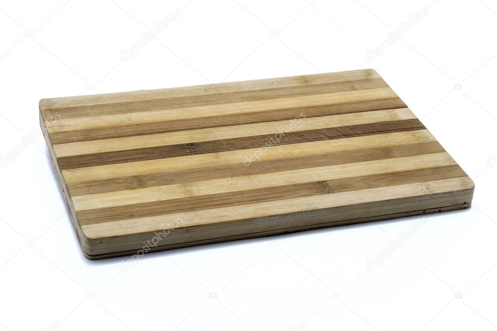 A wooden cutting board on a white background