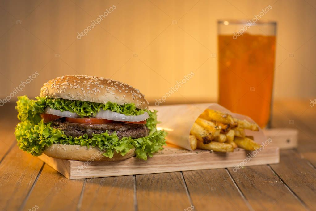 Delicious hamburger with french fries and soda