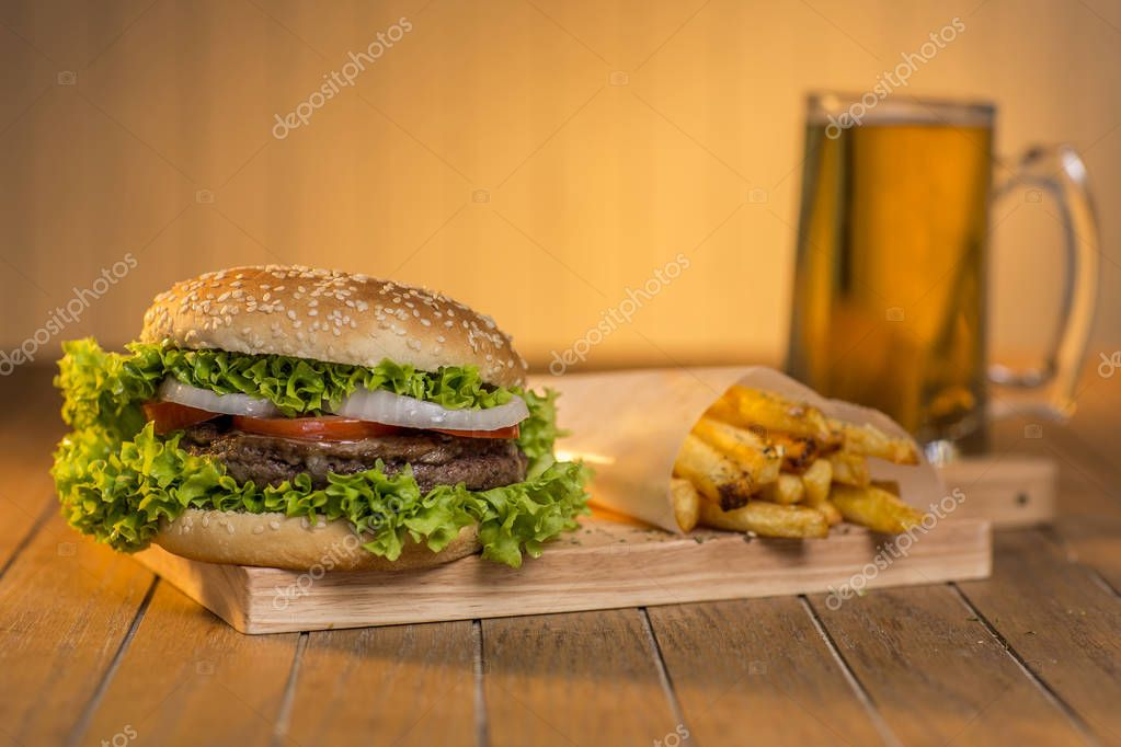 Delicious hamburger with french fries and beer