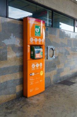 LLORET DE MAR, SPAIN - SEPTEMBER 9, 2018: Automatic external defibrillator at bus station in Lloret de Mar, Spain