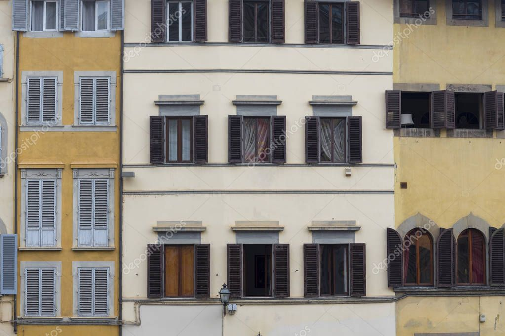 Windows of houses of old houses of Rome in Italy. Beautiful building.