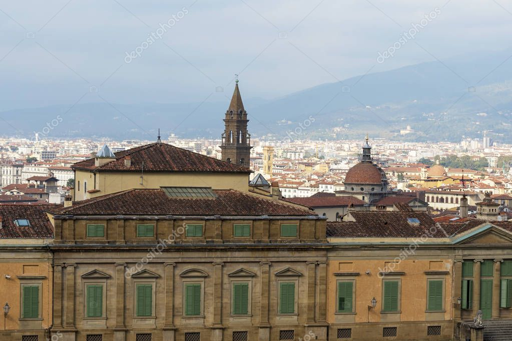 The roof of the Palazzo Pitti overlooking the tower of the Church of Chesea Di San Spirito. Attraction of Florence in Italy.