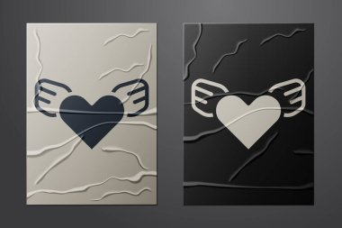 White Heart with wings icon isolated on crumpled paper background. Love symbol. Valentines day. Paper art style. Vector. icon