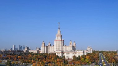 Sunny autumn in the campus of old university in Moscow under blue cloudy sky