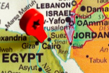 wooden red marker on the map near Cairo