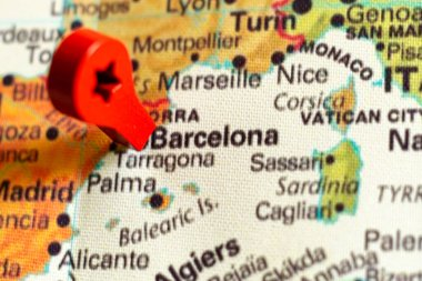 wooden red marker on the map near Barcelona