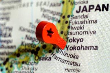 wooden red marker on the map near Yokohama