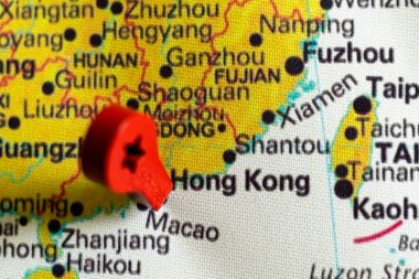 wooden red marker on the map near Hong Kong