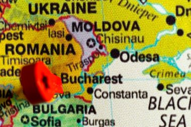 wooden red marker on the map near Bucharest