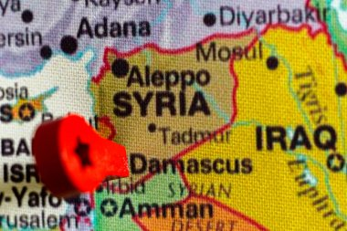 wooden red marker on the map near Damascus