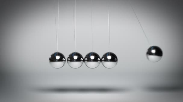 Bouncing Newtons balls against gray background seamless loop