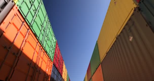 Rows of shipping containers under clear sky seamless loop