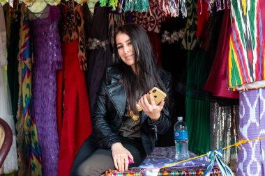 Portrait of beautiful Young woman from Kazakhstan in traditional dress participating in Surajkund Craft Fair, Faridabad, Haryana, India, February 2020