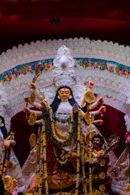 Goddess Durga idol at decorated Durga Puja pandal, shot at colored light, in New Delhi, India. Durga Puja is biggest religious festival of Hinduism and is now celebrated world