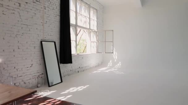 large studio space white cyclorama and natural light from large windows. loft