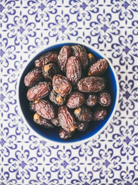 Dates over typical oriental ornamental painted background