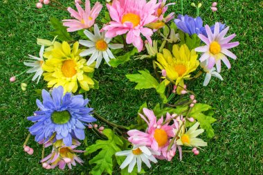 Colorful Spring Plastic Flowers on green grass