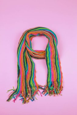 colorful wool Scarf on pink background