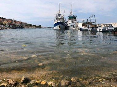 Fishing boats in the harbor of the town Kali on the island of Ugljan in Croatia