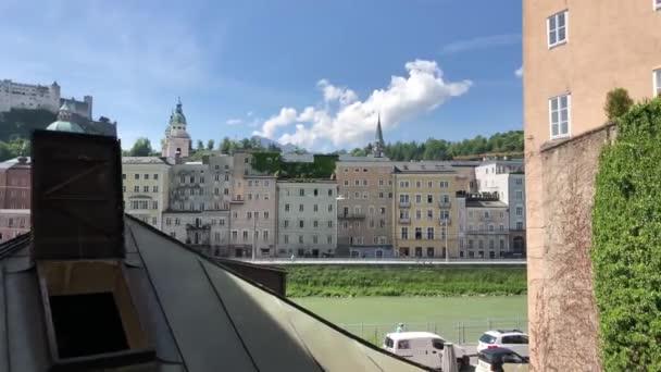 Walking through a gate next to the Salzach river in Salzburg, Austria