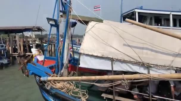 Wooden ferry arriving and leaving the harbor of Rayong, Thailand