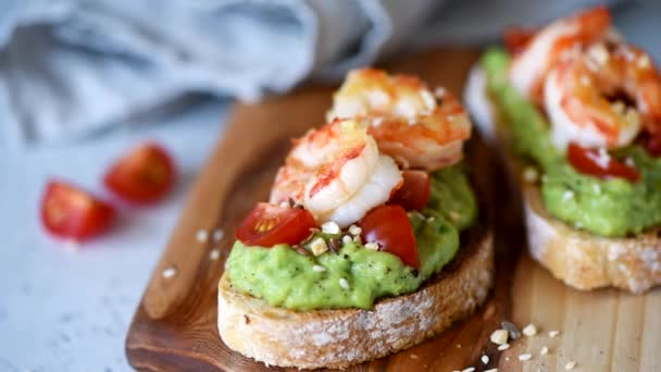 Closeup view of avocado and shrimp bruschetta or toast. Delicious food