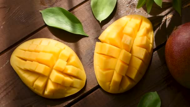 Tasty mango on wooden table, top view. Healthy exotic fruit, vegetarian food