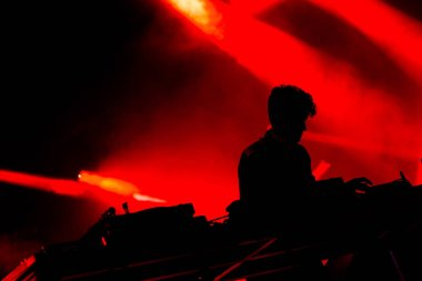 Jamie xx performing on stage during  music festival