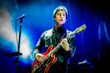 Noel Gallagher performing on stage during music festival