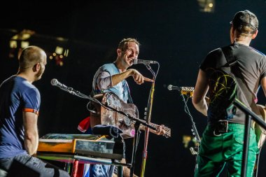 Coldplay performing on stage during  music festival