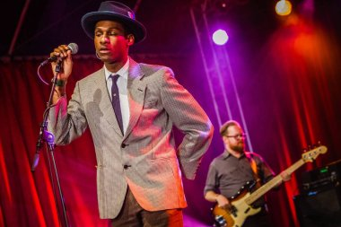 Leon Bridges performing on stage during  music festival