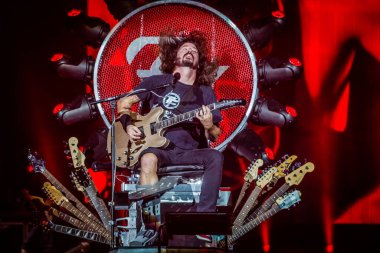 Foo Fighters performing on stage during  music festival