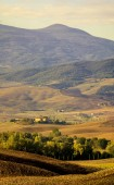Fotografie malebný pohled toskánské krajiny za úsvitu, Pienza, Itálie