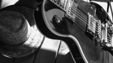 Electric guitar on the wooden boards . Black and white