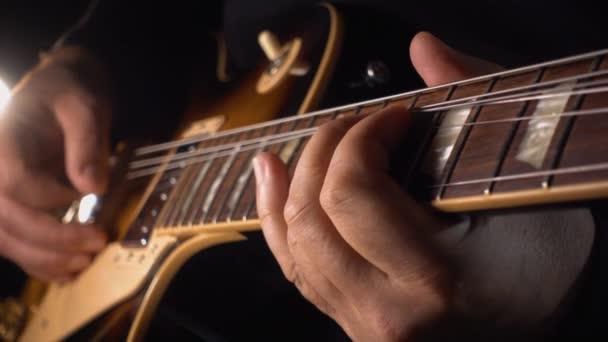 musician playing guitar at studio
