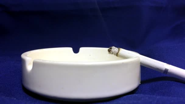 Cigarette are Smoking in the ashtray. The dangers of nicotine and tobacco.