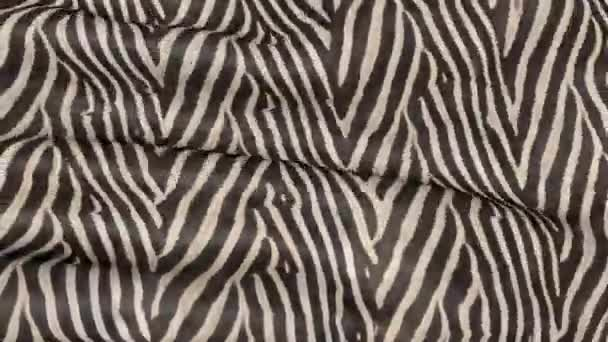 Waves of Zebra-colored fabric. Abstract 3D texture of the movement.