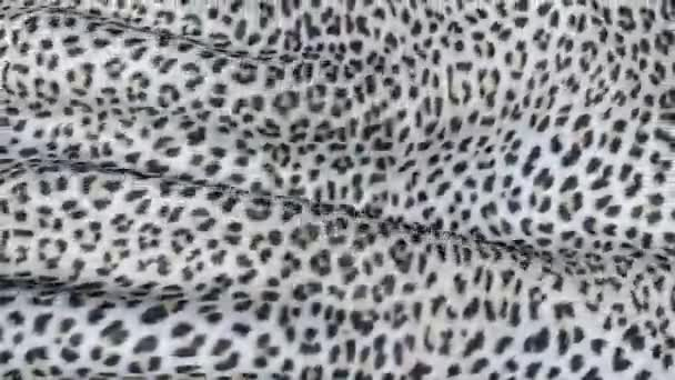 White skin of a leopard in motion. Background of the canvas ripples.
