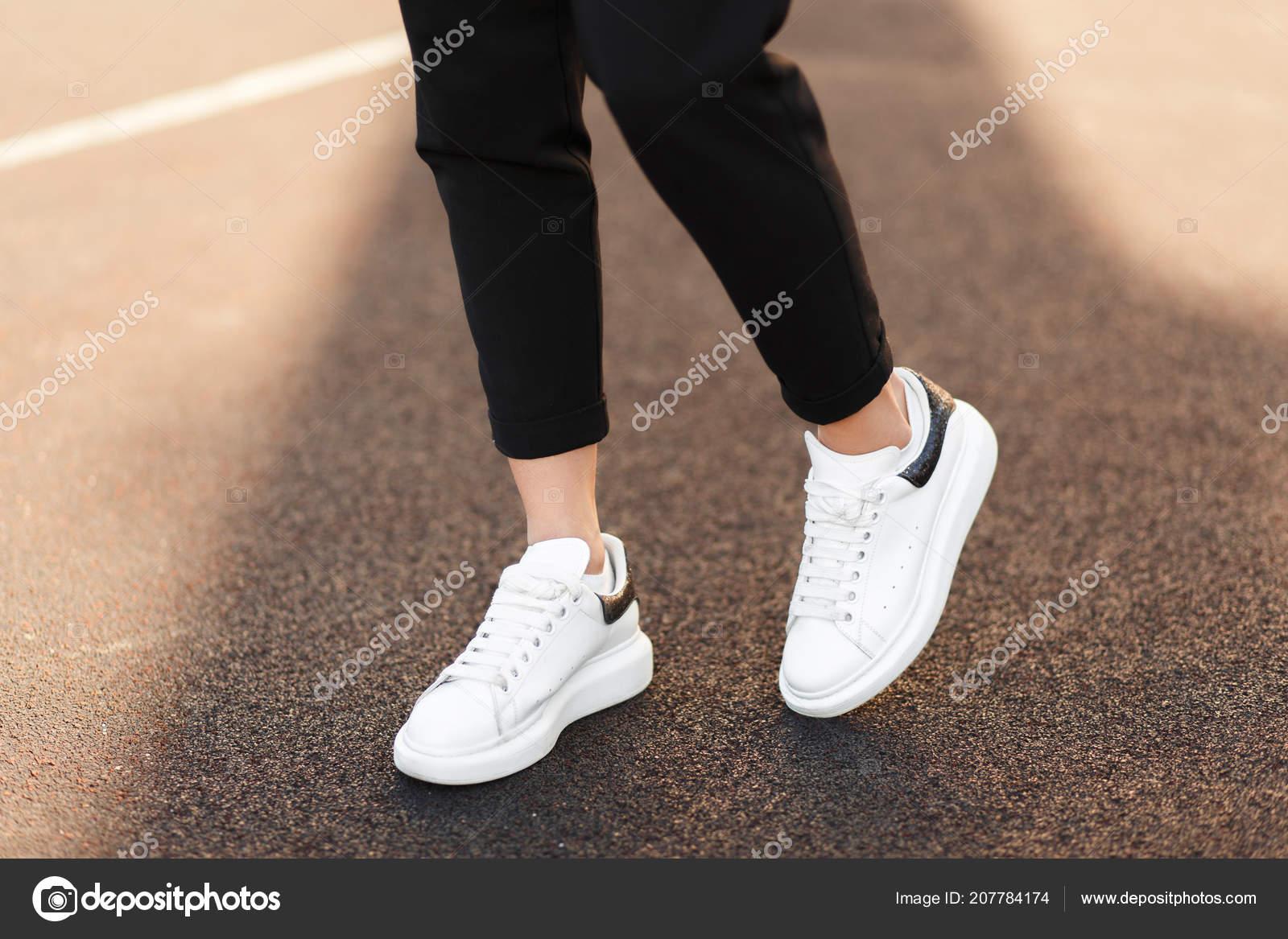 Beautiful Female Legs White Sneakers