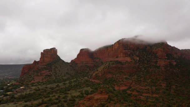 Aerial of massive red rocks in Sedona during cloudy day