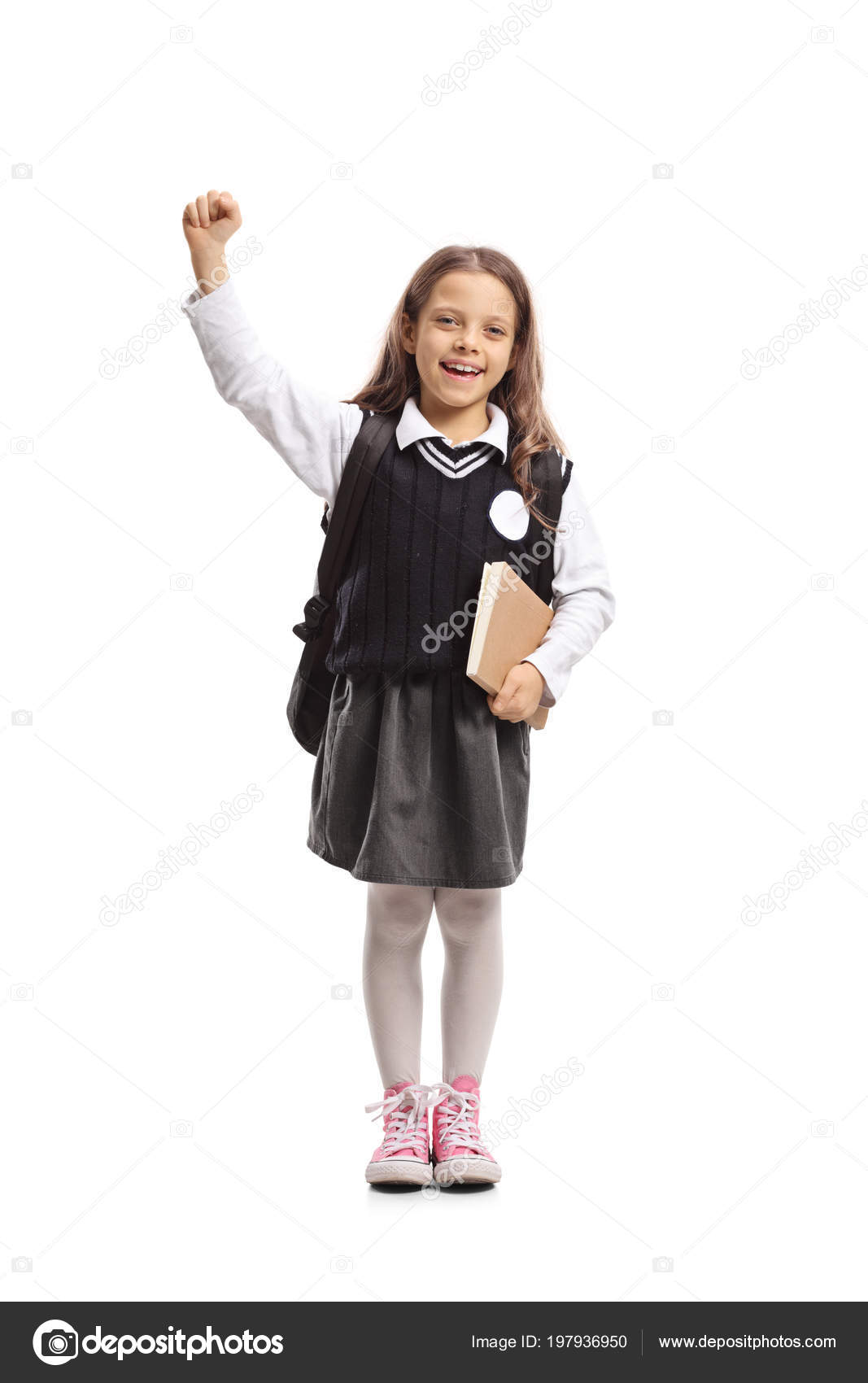 ecbc59681943 Full length portrait of a little schoolgirl with a backpack and a book  gesturing happiness isolated on white background — Photo by ljsphotography