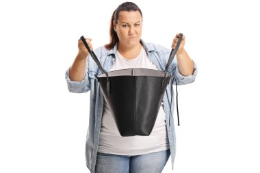 Angry overweight female holding a handbag isoated on white background