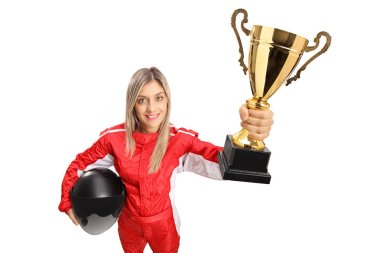 Woman racer in a suit holding a gold trophy cup isolated on white background