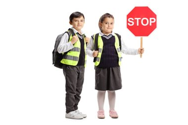 Full length portrait of a schoolboy and a schoolgirl with safety vests and a stop sign isolated on white background stock vector